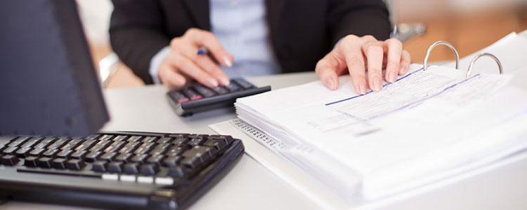 man looking through paperwork