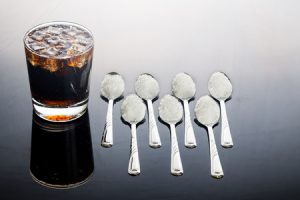 amount of sugar in a small glass of coca cola
