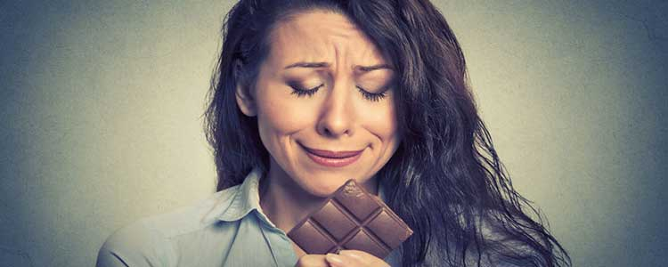 Woman Looking at Chocolate
