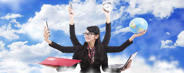 young dark haired business woman holding multiple objects