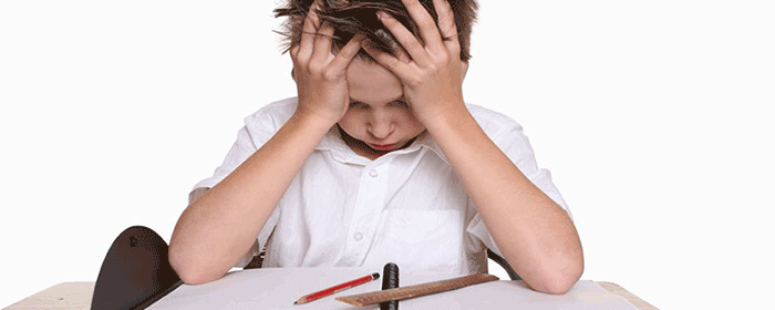 A frustrated, upset child struggling to learn