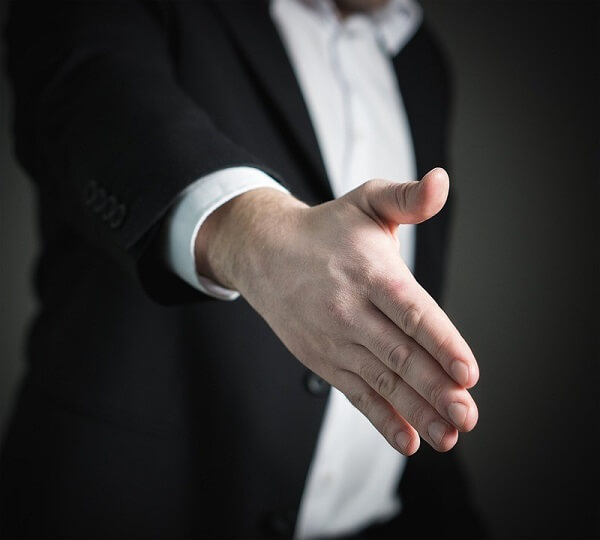 man preparing to shake hands