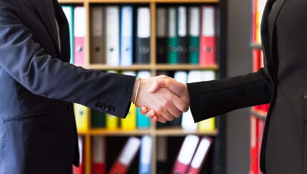 handshake over a promotion