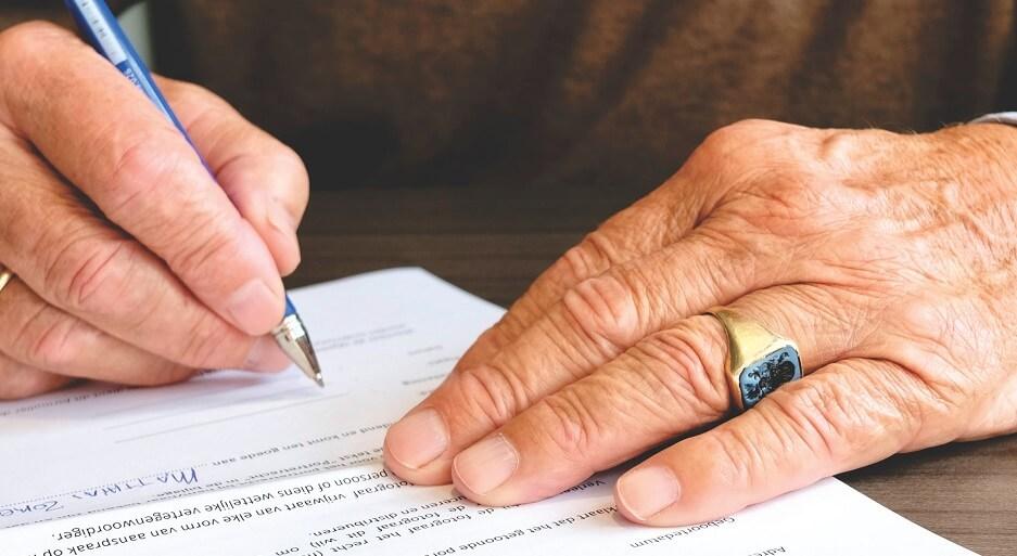 man editing CV
